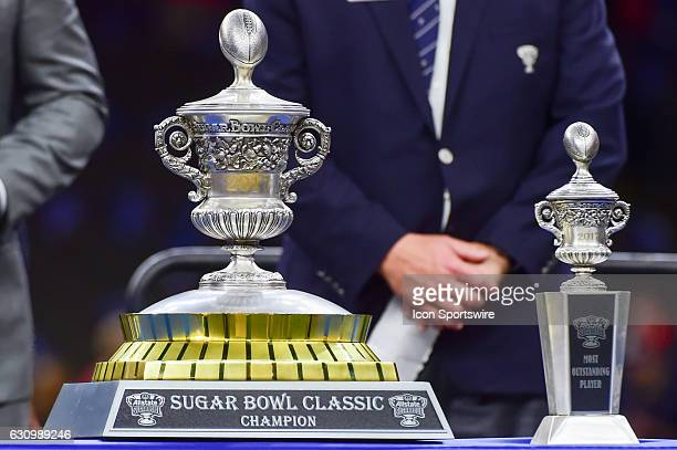 The Sugar Bowl championship trophy and the MVP trophy stand ready for post game presentations during the Sugar Bowl game between the Auburn Tigers...