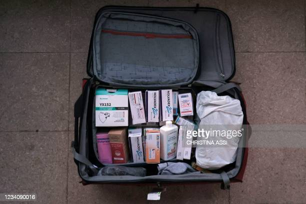 The suitcase of a Lebanese expat is packed with medicines and vital supplies ahead of travelling to Lebanon, in the Cypriot port city of Larnaca on...