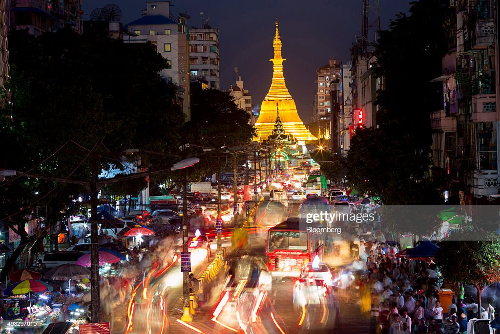 The Sule Pagoda stands illuminated as light trails are left by moving traffic in this long exposure photograph at night in Yangon, Myanmar, on Thursday, Oct. 15, 2015. Myanmar's government signed a cease-fire agreement with half of the nation's armed ethnic groups, a partial victory for President Thein Sein less than a month before an historic national election. Photographer: Brent Lewin/Bloomberg via Getty Images