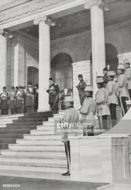 The Sultan Mehmet V Enver Pasha and the ministers in prayer after the bombing of the Dardanelles Istanbul Istanbul Turkey World War I from...