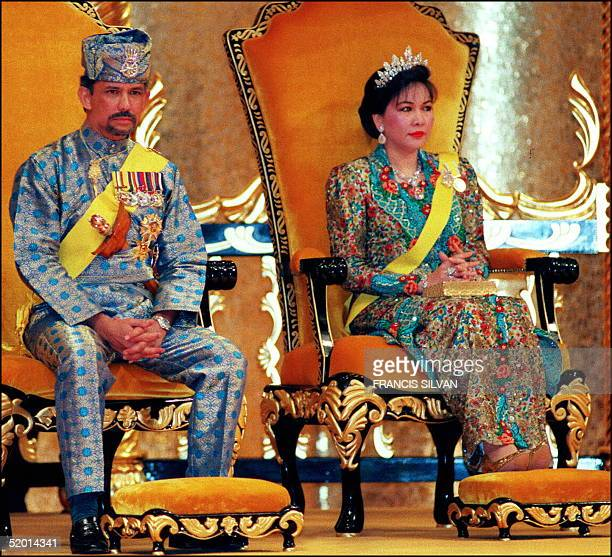 The Sultan of Brunei Hassanal Bolkiah and Queen Hajah Mariam shown in this file picture dated 15 July 1996 as they sit on the throne during an...