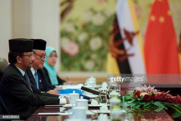 The Sultan of Brunei, Hassanal Bolkiah speaks during his meeting with Chinese Premier Li Keqiang at The Great Hall Of The People on September 13,...