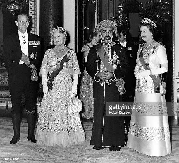 The Sultan of Oman His Majesty Qaboos Bin Said with the Duke of Edinburgh the Queen Mother and the Queen before a banquet held in his honour at...