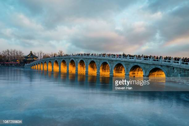 the summer palace and seventeen arch bridge scenery in beijing, china - ancient history stock pictures, royalty-free photos & images
