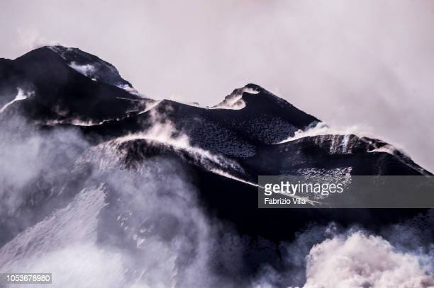 The summit craters of Etna volcano seen from the helicopter of the Italian Coast Guard The helicopter flew over to over 4000 meters of height to give...