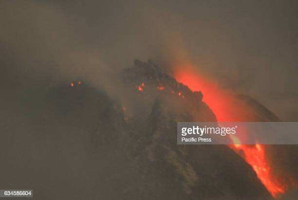 The summit of Mount Sinabung still burns and continue to flow lava as seen from Perteguhen Village during the earthquake hit Deli Serdang and Karo...