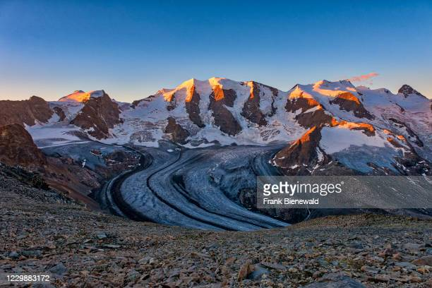 The summits of Piz Cambrena, Piz Palü and Bella Vista and the upper part of Pers Glacier, seen from Munt Pers near Diavolezza at sunrise.
