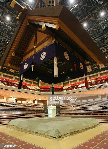 The sumo 'dohyo' or ring is covered with a large sheet at the Kokugikan sumo gymnasium in Tokyo on February 6 2011 Japan's sumo authority cancelled...