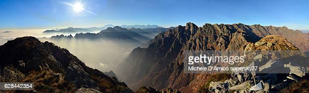 the sun above rugged mountain ridges. - monte rosa foto e immagini stock