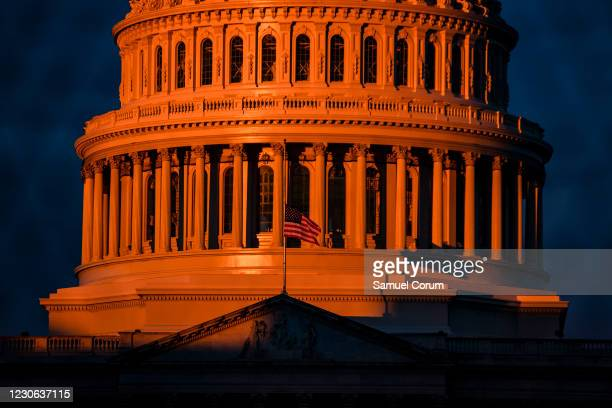 The sun begins to hit the dome of the U.S. Capitol on the morning of January 17, 2021 in Washington, DC. After last week's riots at the U.S. Capitol...