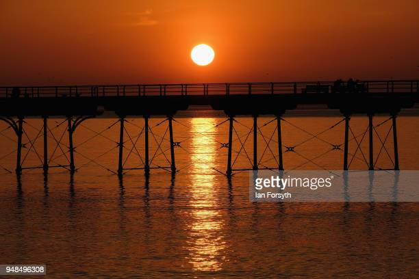 The sun begins to rise behind Saltburn pier on what is expected to be the hottest day of the year so far on April 19 2018 in Saltburn By The Sea...