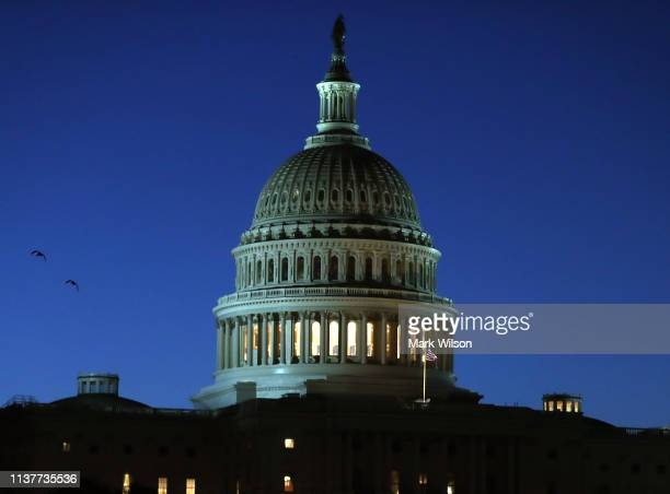 The sun begins to rise behind the US Capitol building on March 23 2019 in Washington DC Yesterday special counsel Robert Mueller delivered his report...