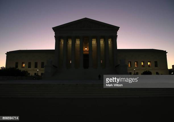 The sun begins to rise behind the US Supreme Court on October 2 2017 in Washington DC This session the high court will hear several cases including...