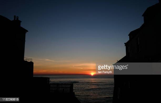 The sun begins to rise over Robin Hood's Bay on February 26 2019 in Robin Hood's Bay England Warm weather continues to sweep the country as the...