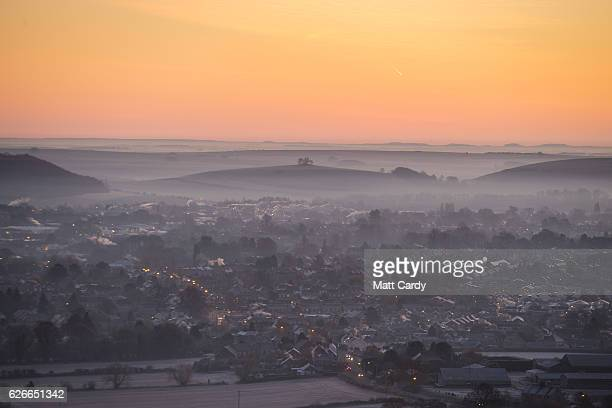 The sun begins to rise over the town of Warminster viewed from the National Trust's Cley Hill as the country wakes up to subzero temperatures on...