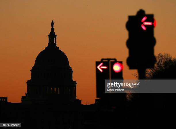 The sun begins to rise over Washington as the federal government is in a partial shutdown, on December 23, 2018 in Washington, DC. Republicans and...