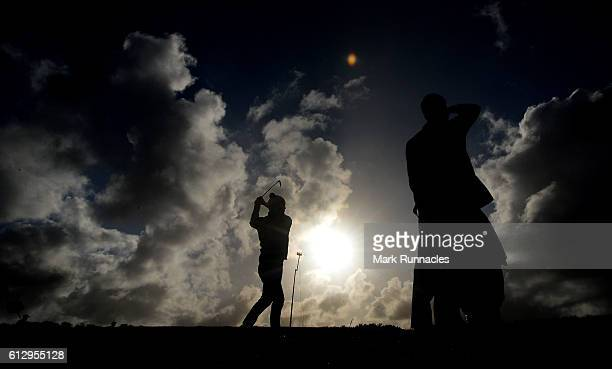The Sun begins to set as Morten Orum Madsen of Denmark plays his second shot to the 9th during the first round of the Alfred Dunhill Links...