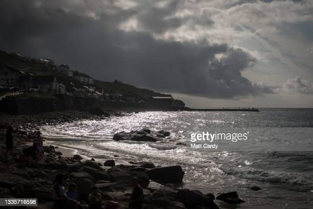 The sun begins to set at Sennen Cove on August 20, 2021 near Penzance in Cornwall, England. The ongoing international travel restrictions due to the...