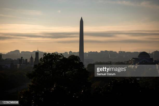 The sun begins to set over the National Mall and Washington Monument on October 26, 2020 in Washington, DC. It is expected that the Senate will vote...