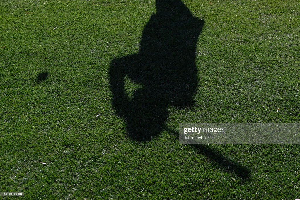 The sun casts a shadow during the Colorado Rockies workout on February 20, 2018 at Salt River Fields at Talking Stick in Scottsdale, Arizona.