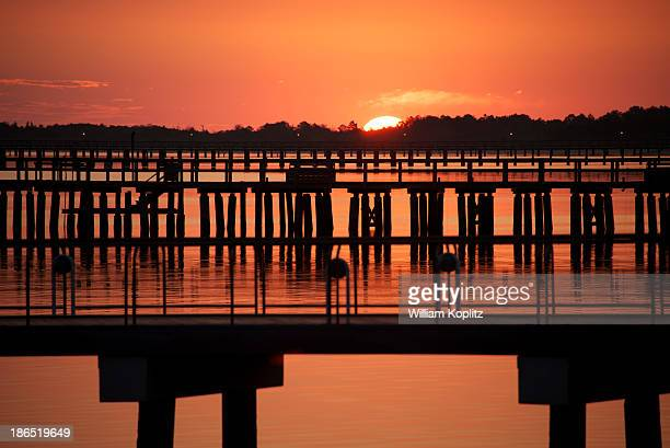 CONTENT] The sun casts an orange light at sunrise over the Delaware Bay docks near Lewes Delaware