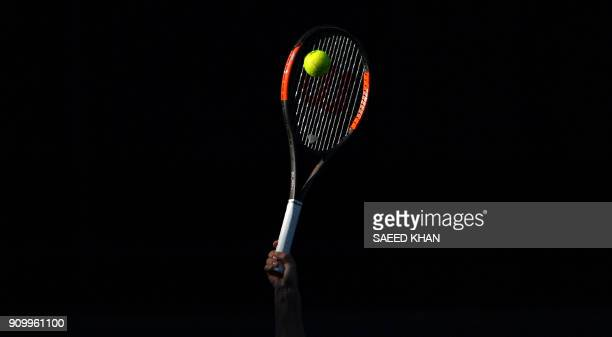 The sun catches the racquet of Romania's Simona Halep as she serves to Germany's Angelique Kerber during their women's singles semifinals match on...