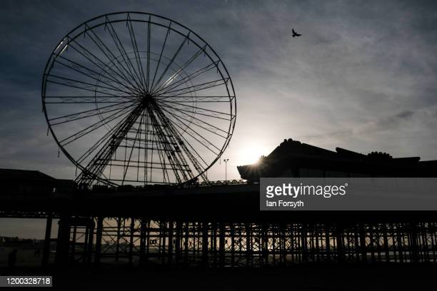 The sun climbs over the Central pier on Blackpool seafront on January 18 2020 in Blackpool England Warmer weather has taken over following the recent...