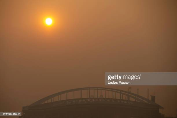The sun goes down in front of CenturyLink Field on September 11, 2020 in Seattle, Washington. According to reports, air quality is expected to worsen...