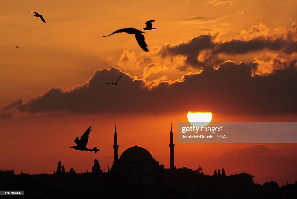 The sun goes down over the Sulymaniye Mosque on June 17, 2013 in Istanbul, Turkey.