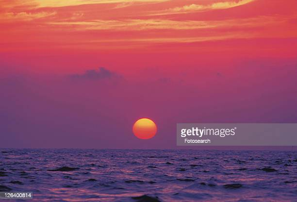 the Sun Going Down at Sea, the Sky Reflecting the Colors of the Sun, Front View