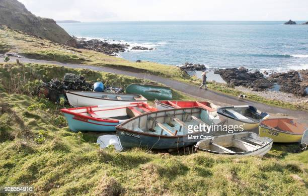 The sun illuminates fishing boats left at Priest's Cove at Cape Cornwall near Penzance on March 6 2018 in Cornwall England Last week freezing weather...