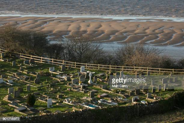 The sun illuminates headstones in a cemetery in Clevedon on January 4 2018 in North Somerset England According to the property website Zoopla house...