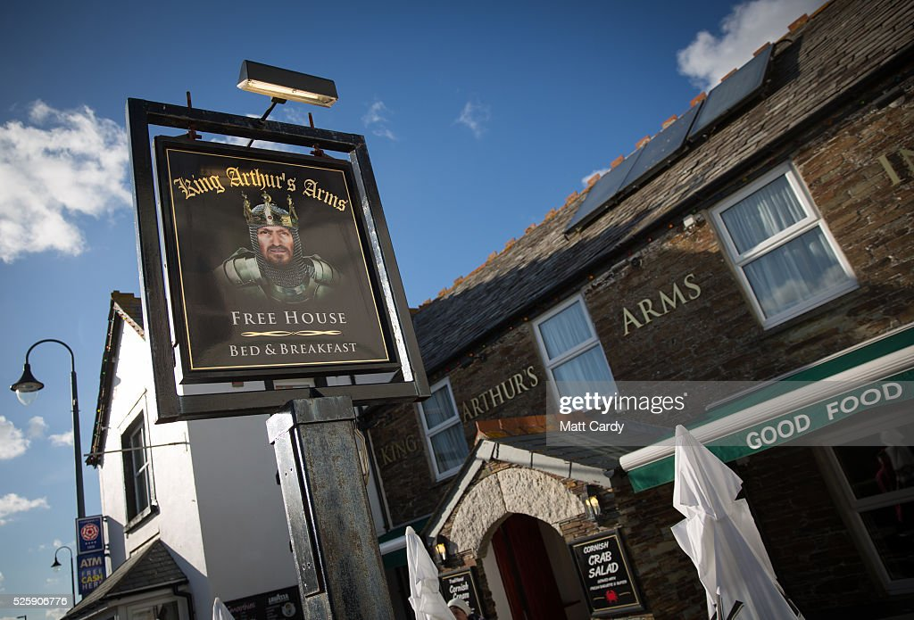 The sun illuminates the sign for the King Arthur's Arms in Tintagel on April 27, 2016 in Cornwall, England. The English Heritage managed site and the nearby town have long been associated with the legend of King Arthur and continue to attract large visitor numbers. However, efforts by English Heritage to update the visitor experience with the Gallos sculpture, along with a rock carving of Merlin's face, which English Heritage say are inspired by the legend of King Arthur and Tintagel Castles royal past, have met with criticism from some Cornish nationalists and historians.