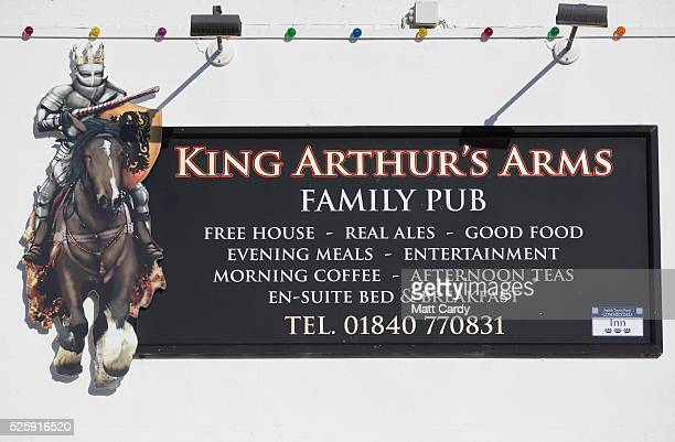 The sun illuminates the sign for the King Arthur's Arms in Tintagel on April 27 2016 in Cornwall England The English Heritage managed site and the...