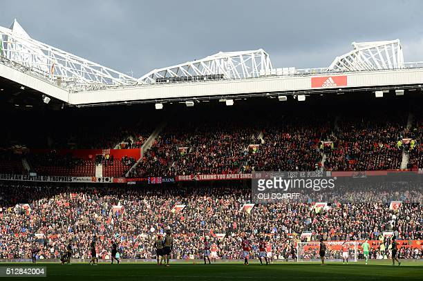 The sun illuminates the stands during the English Premier League football match between Manchester United and Arsenal at Old Trafford in Manchester...