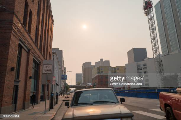 The sun is almost entirely obscured by smoke from the Napa wildfires on Folsom Street in San Francisco California October 13 2017 Smoke from the...