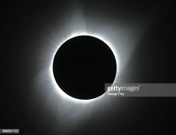 The sun is is in full eclipse over Grand Teton National Park on August 21 2017 outside Jackson Wyoming Thousands of people have flocked to the...