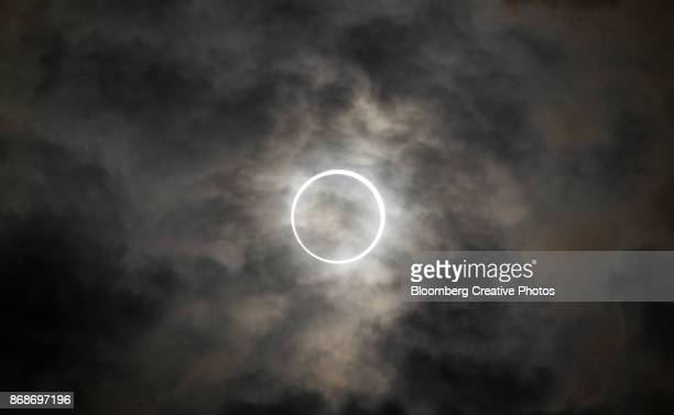 the sun is obscured by the moon during an annular solar eclipse - 金環日食 ストックフォトと画像