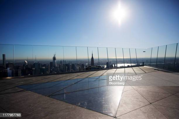 The sun is reflected on the Edge observation deck at 30 Hudson Yards during a media preview event in New York US on Thursday Oct 24 2019 Edge is...