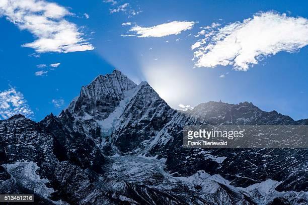 The sun is rising over the mountain Kangtega