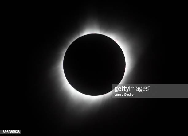 The sun is seen in full eclipse over a park on August 21 2017 in Hiawatha Kansas Millions of people have flocked to areas of the US that are in the...