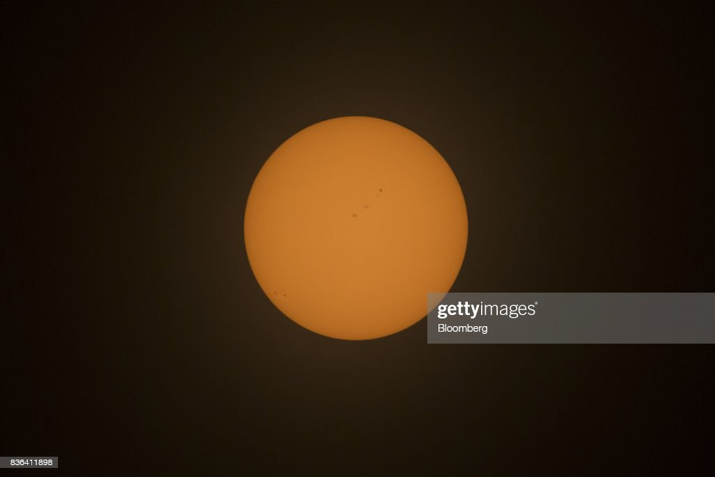 The sun is seen prior to the start of a solar eclipse from the campus of Southern Illinois University (SIU) in Carbondale, Illinois, U.S., on Monday, Aug. 21, 2017. Millions of Americans across a 70-mile-wide (113-kilometer) corridor from Oregon to South Carolina will see the sky darken as the sun disappears from view total during the eclipse, with Carbondale seeing totality for 2 minutes and 38 seconds. Photographer: Daniel Acker/Bloomberg via Getty Images