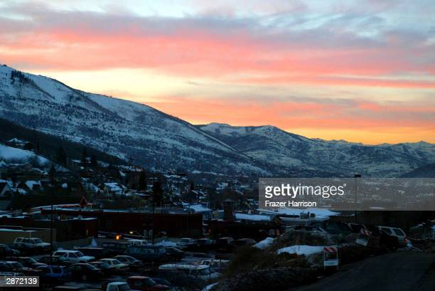 The sun is seen setting over Park City on the first day of the Sundance film festival January 15 2003 in Park City Utah