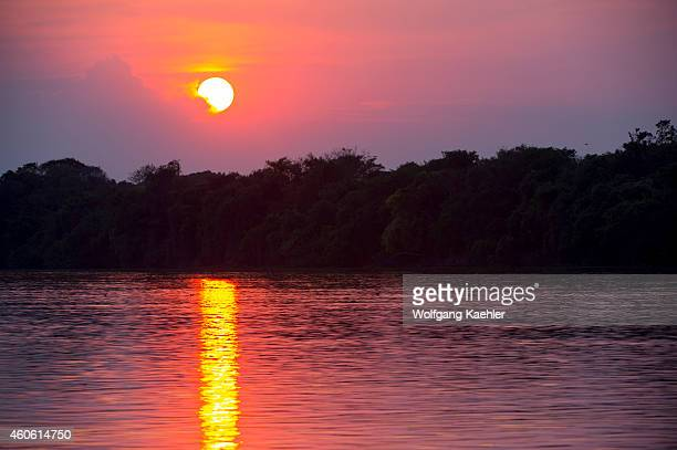 The sun is setting over the Cuiaba River at Porto Jofre in the northern Pantanal, Mato Grosso province in Brazil.