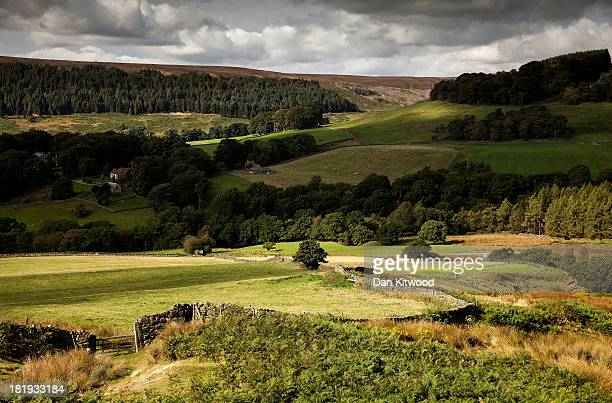 The sun lights up a valley in the North York Moors near Cockayne on September 22, 2013 in Pickering, England. More seasonal Autumnal weather is...