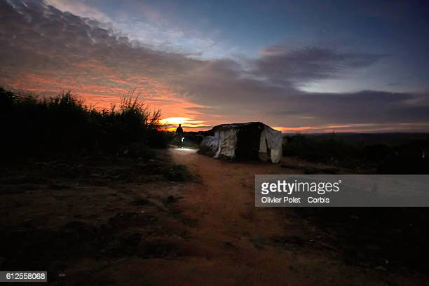The sun points at the horizon as a worker gets ready to leave for the 7/7 diamond mining site outside an Angolan village near the Congolese border 28...
