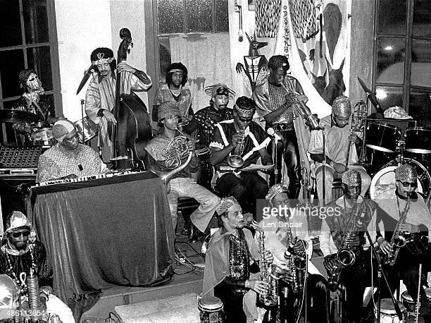 The Sun Ra Arkestra at the Detroit Jazz Center on December 31 1979 in Detroit Michigan Back row from left Eric Walker Jaribu Shahid Tani Tabbal...