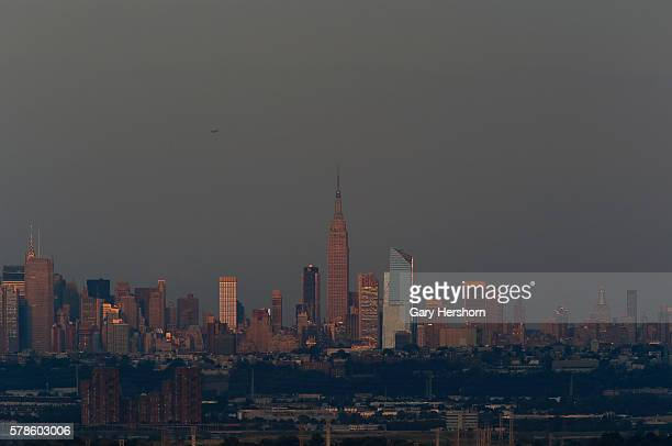 The sun reflects off buildings on the skyline of New York City on July 19 2016 as seen from Montclair NJ