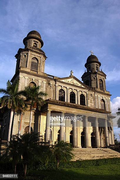 The sun reflects off the ruins of the old Nicaragua cathedral that stands in front of the Presidential Home located on the southern end of Managua...