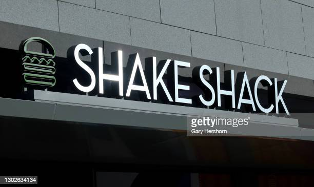The sun reflects off the sign of a new Shake Shack restaurant being constructed on February 16, 2021 in Hoboken, New Jersey.